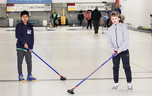 two boys curling