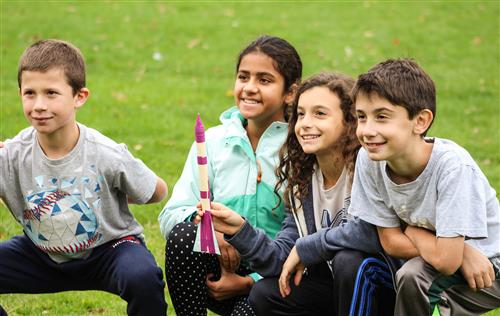 Students pose with a rocket