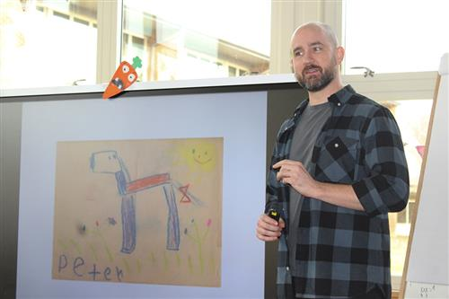 Author Peter Brown displays a drawing of a dog